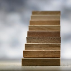 wooden blocks arranging as step stair, Concept of growth and success plan.