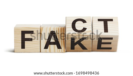 Wooden blocks forming words 'Fact' and 'Fake', isolated on white background ストックフォト ©