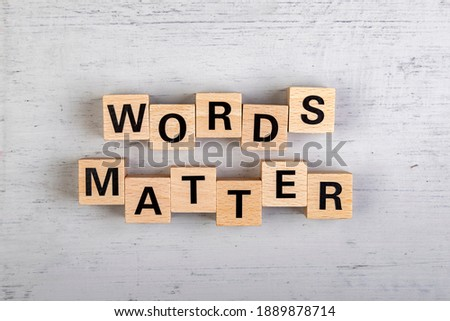 wooden blocks  in a white and grey board with the text words matter Stock photo ©