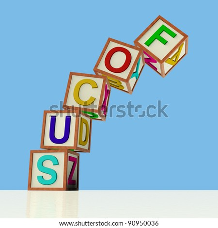 Wooden Blocks Spelling Focus Falling Over As Symbol for Lack Of Concentration