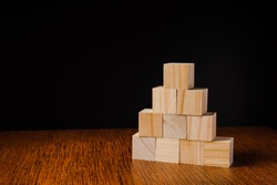 Wooden blocks stacked against black background