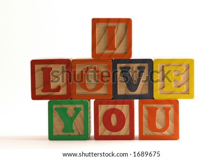 "Wooden blocks stacked horizontally, spelling ""I Love You"""