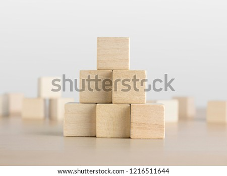 Wooden blocks stacking as a pyramid staircase on white background. Success, growth, win, victory, development or top ranking concept. Stock foto ©