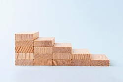 Wooden blocks stacking as step stair. Business growth success. Money business and investment growth and banking concept. Investing money for retirement. Inflation and tax hikes
