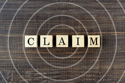 Wooden blocks with CLAIM word and concentric circle