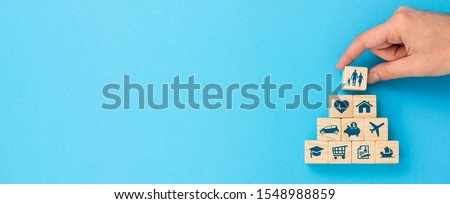 Wooden blocks with icons of various types of insurance. Life insurance concept. #1548988859