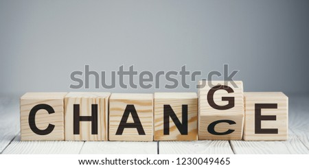 """Wooden blocks with letters forming words """"Chance"""" and """"Change"""" on neutral background #1230049465"""