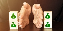 wooden blocks with money bag icon separated into two group by hands show that money management concept.