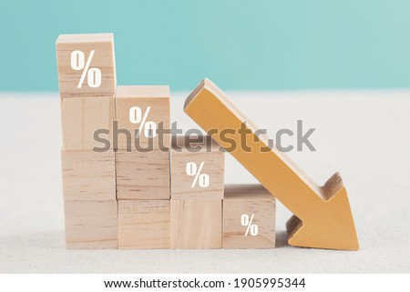 Wooden blocks with percentage sign and down arrow, financial recession crisis, interest rate decline, investment reduce, risk management concept ストックフォト ©