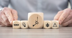 Wooden blocks with symbol of phishing concept