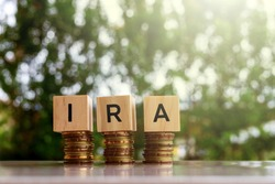 Wooden blocks with text IRA Business and finance concept.
