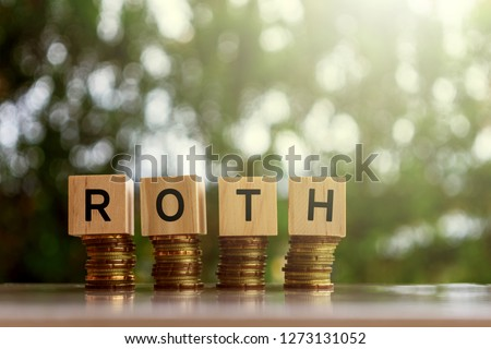 Wooden blocks with text ROTH. Business and finance concept.