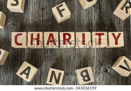 Wooden Blocks with the text: Charity