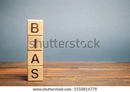 Wooden blocks with the word Bias. Prejudice. Personal opinions. Preconception