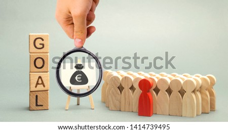 Wooden blocks with the word Goal, money and business team. Business concept. Cooperation and teamwork. Improving the efficiency of the company's sales. Achieving financial targets. Increase profits #1414739495