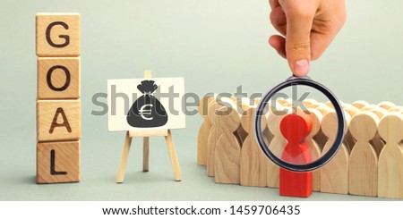 Wooden blocks with the word Goal, money and business team. Business concept. Cooperation and teamwork. Improving the efficiency of the company's sales. Achieving financial targets. Increase profits