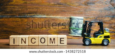 Wooden blocks with the word Income, money and a forklift. Profit and budget. Return on investment. Successful profitable business. Performance. Finance and salary. Revenue in the company. Analysis #1438272518