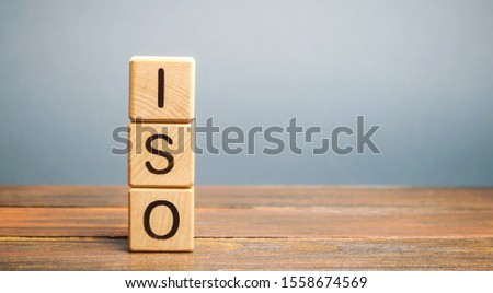 Wooden blocks with the word ISO. International organization for standardization. Quality standard #1558674569
