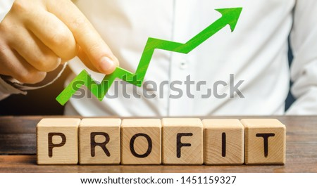 Wooden blocks with the word Profit and an up arrow. Concept of business success, financial growth and wealth. Increase profits and investment fund. Performance. Profitable business. ROR, ROI #1451159327
