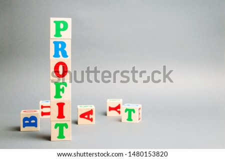 Wooden blocks with the word Profit and randomly scattered cubes. The financial result of the company for a certain period of time. Income. Return on investment. Performance. Profitable business. #1480153820