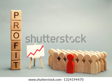 Wooden blocks with the word profit and the graph up stands near the team. Concept of business success, financial growth and wealth. Increase profits and investment fund. Economic boom High performance #1324194470