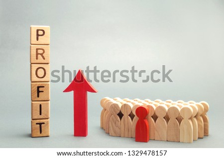 Wooden blocks with the word profit and the graph up stands near the team. Concept of business success, financial growth and wealth. Increase profits and investment fund. Economic boom High performance #1329478157