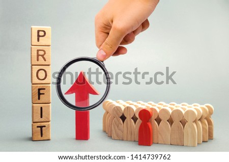 Wooden blocks with the word profit and the graph up stands near the team. Concept of business success, financial growth and wealth. Increase profits and investment fund. Economic boom High performance #1414739762