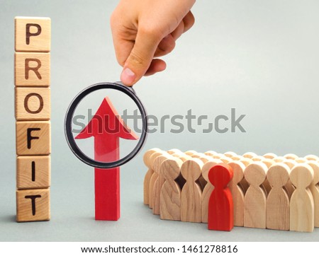 Wooden blocks with the word profit and the graph up stands near the team. Concept of business success, financial growth and wealth. Increase profits and investment fund. Economic boom High performance #1461278816