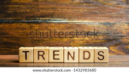 Wooden blocks with the word Trends. Main trend of changing something. Popular and relevant topics. New ideological trends of fashion. Recent and latest trend. Evaluation methods. Fashionable