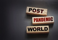 Wooden blocks with words Post-pandemic world. New normal social and business concept.