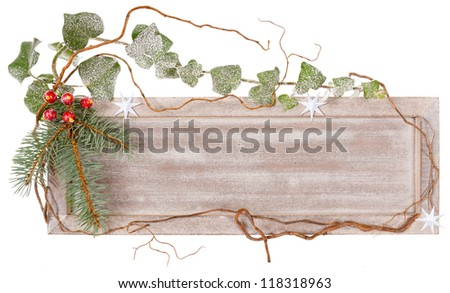 Wooden board decorated with ivy, spruce and artificial berries