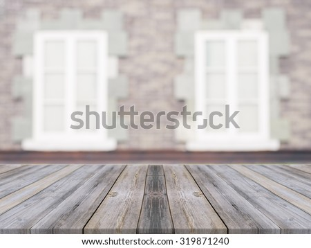 Wooden board empty table in front of blurred background. Perspective grey wood over blur ceramic tile brick wall in background - can be used for display or montage your products.