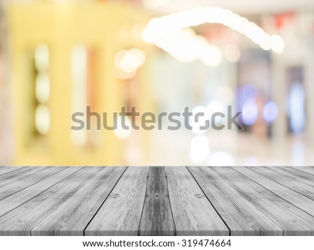 Wooden board empty table in front of blurred background. Perspective grey wood over blur in coffee shop - can be used for display or montage your products.Mock up for display product.Vintage filter.