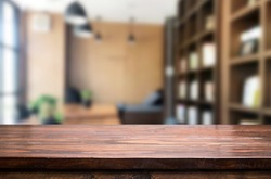Wooden board empty Table Top And Blur Interior over blur in coffee shop Background, Mock up for display of product.