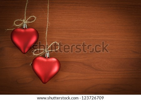 wooden board for valentine message with two red hearts
