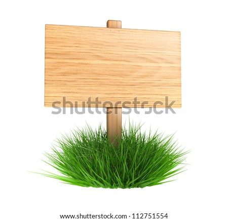 Wooden board on a grass - isolated on white background