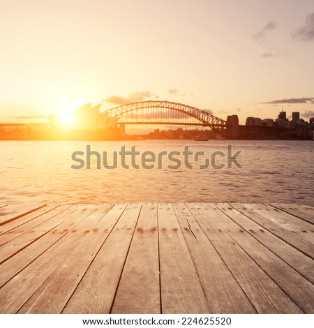 Wooden board, Sydney in sunset.