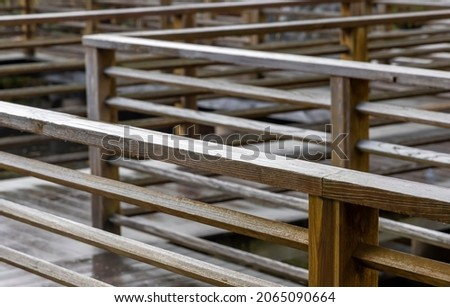 Wooden board walk with hand rails close up view