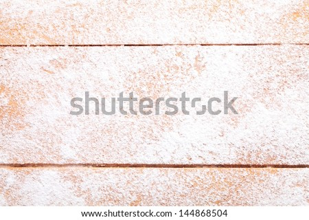 Wooden board with powdered sugar