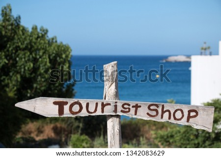 "Wooden Board with the inscription shop for tourists. ""Tourist shop"""