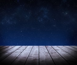 Wooden boards and night sky on background
