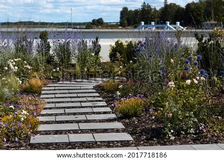Wooden boardwalk in the green garden. High quality photo Сток-фото ©