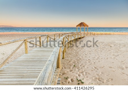 Wooden boardwalk to the beach. Idyllic scene in Trafalgar coast, Cadiz, Spain.