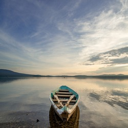 Wooden boat on lake Panoramic view