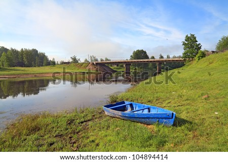 wooden boat on river coast near villages