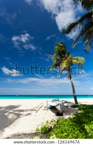 Wooden boat on tropical beach with white sand, Philippines, Boracay