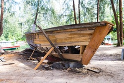 Wooden boat repare, old damaged wooden boat, Thai style boat, outdoor day light