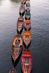 Wooden boats for hire moored on the River Thames, London, England