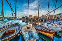 Wooden boats in La Maddalena harbor at sunset. Sardinia, Italy