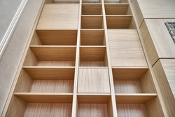 Wooden bookshelves. Wooden bookcases and wall panels made of oak veneered MDF. Close-up